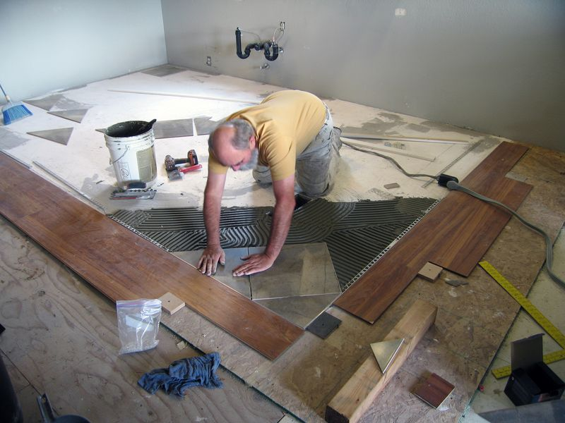 Placing tiles on a bed of mortar