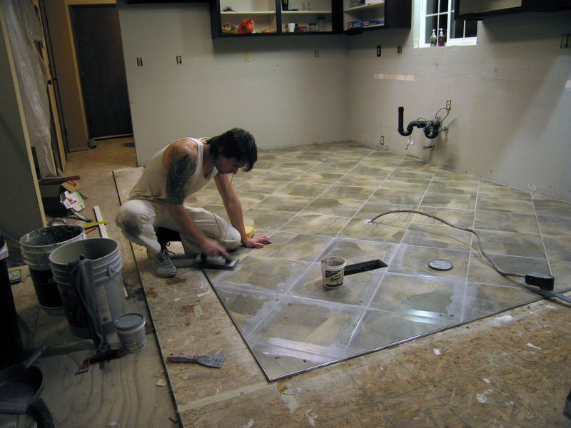 Grouting the grooves between the tiles