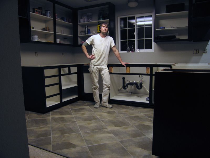 My brother and his new tiled kitchen floor